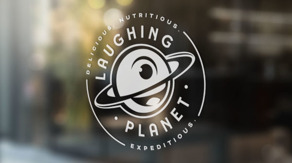 Laugning Planet logo on window