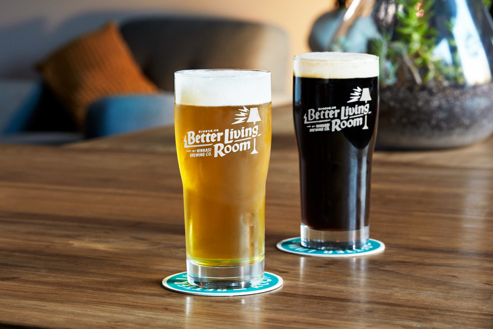 Two pints of beer with Better Living Room Logo