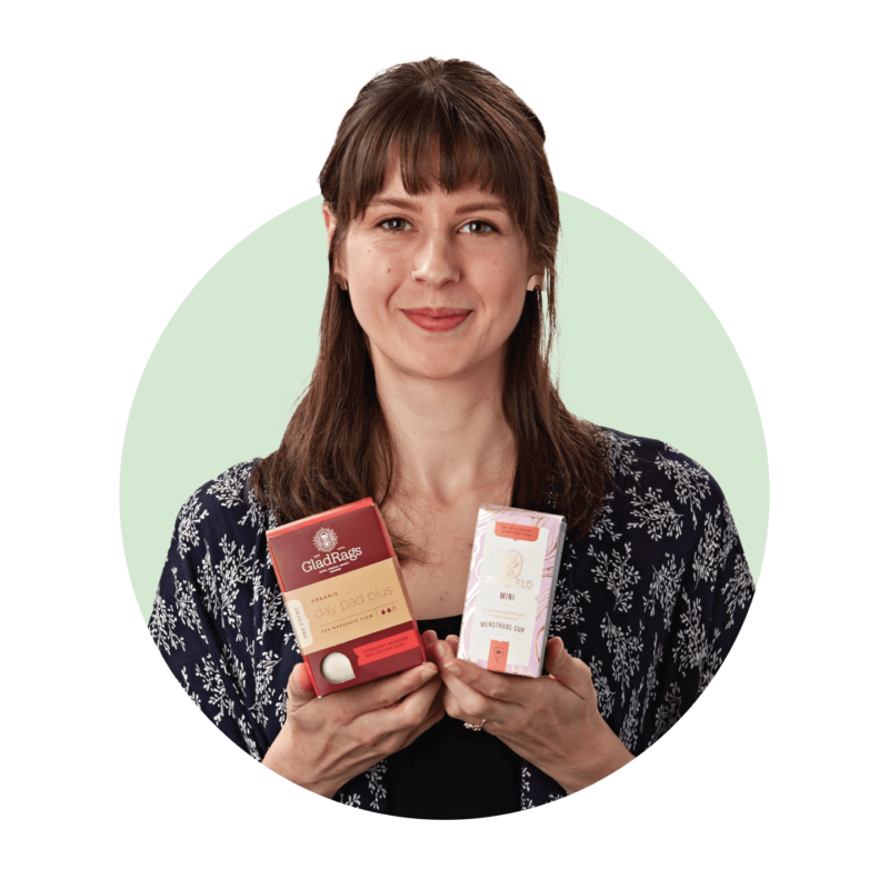 GladRags founder Tracy Puhl holding GladRags and XoFlo packaging