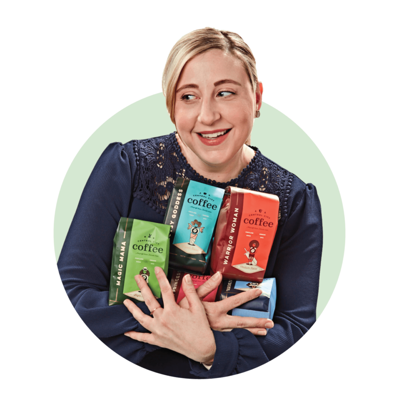 Sarah Porter holding Central City Coffee packaging